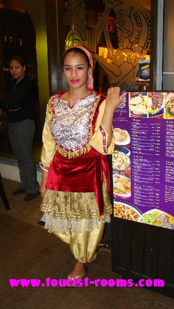 filipina waitress dressed in traditional costume outside restaurant at Robinsons Place Manila shopping mall at malate