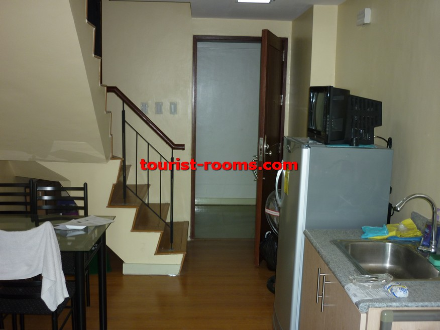 STAIRCASE AND TV AND REFRIGERATOR AT GATEWAY GARDEN HEIGHTS,GATEWAY GARDEN HEIGHTS,MANILA APARTMENTS FOR RENT,APARTMENT NEAR BONI MRT STATION FOR RENT,APARTMENT NEAR FORUM ROBINSONS MALL FOR RENT,APARTMENT AT MANDALUYONG FOR RENT,MANDALUYONG APARTMENT,MANDALUYONG APARTMENT FOR RENT