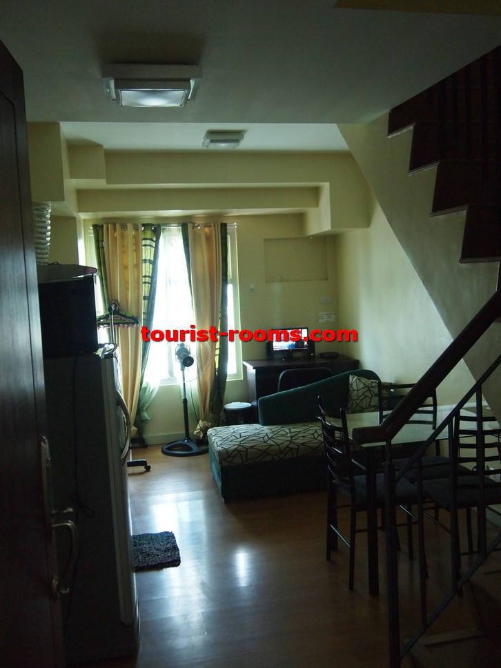 LIVING ROOM AND STAIRCASE AT GATEWAY GARDEN HEIGHTS,GATEWAY GARDEN HEIGHTS,MANILA APARTMENTS FOR RENT,APARTMENT NEAR BONI MRT STATION FOR RENT,APARTMENT NEAR FORUM ROBINSONS MALL FOR RENT,APARTMENT AT MANDALUYONG FOR RENT,MANDALUYONG APARTMENT,MANDALUYONG APARTMENT FOR RENT