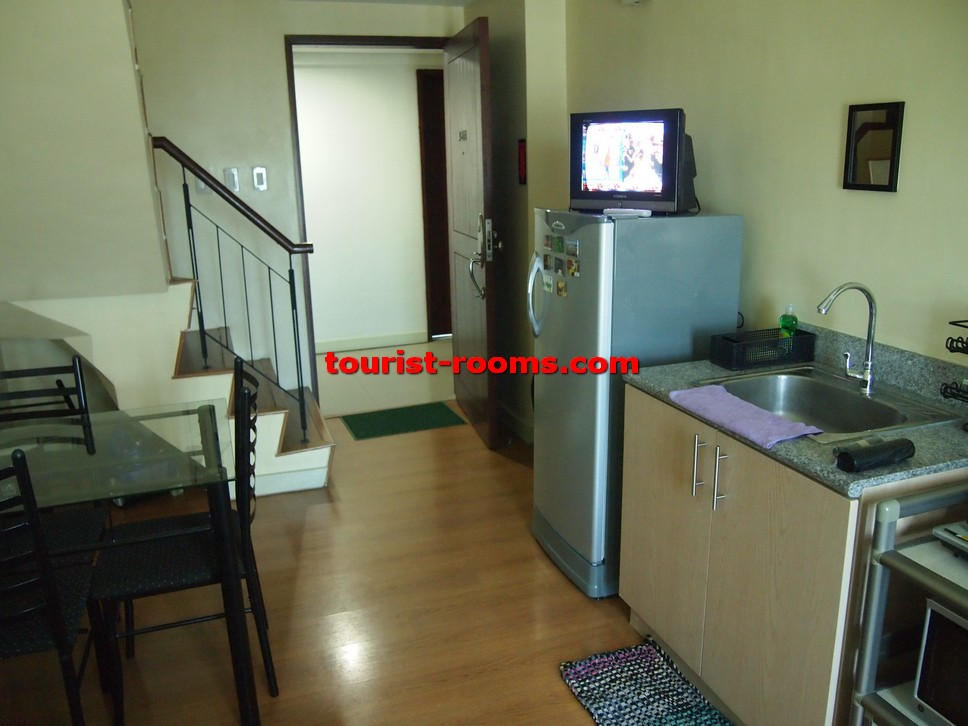 DINING AND KITCHEN AREA AND STAIRCASE AT GATEWAY GARDEN HEIGHTS,GATEWAY GARDEN HEIGHTS,MANILA APARTMENTS FOR RENT,APARTMENT NEAR BONI MRT STATION FOR RENT,APARTMENT NEAR FORUM ROBINSONS MALL FOR RENT,APARTMENT AT MANDALUYONG FOR RENT,MANDALUYONG APARTMENT,MANDALUYONG APARTMENT FOR RENT